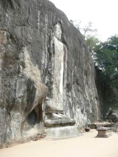The cave beside the statue of Budhha, from where an oil trickles