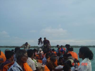 The ferry boat was crowded with men, women and children seated all over with their bags and baggage