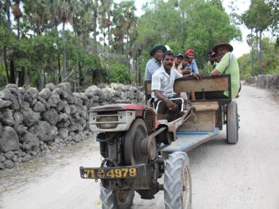 The principal way of traveling for a large crowd, such as the ten of us, was in a trailer pulled by a two wheel tractor engine - called a Land Master