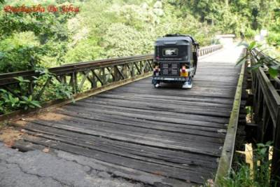 nteresting bridge with an iron frame and wooden planks