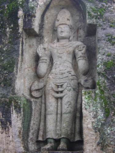 rock carved statue of a regal figure