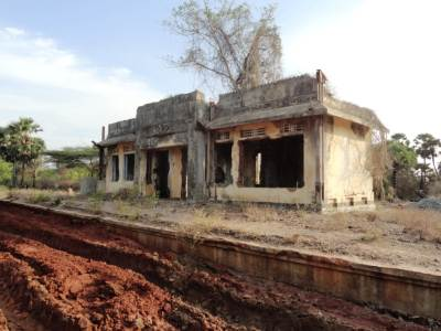 Old Thoddaveli station in ruins.... but can see the recently dug earth for the new railway line