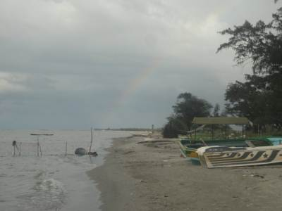 Casurina beach, a rainbow is faintly visible in the back ground