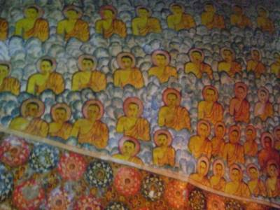 paintings of about 100 Arahath Bickkus at the roof of the cave