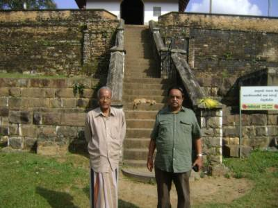 Mr. Gunasinghe and myself in front of devalaya