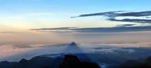 shadow of adams peak created on mist