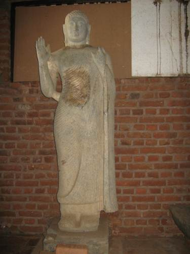 A beautiful statue. Dark coloured patches are repaired sections following damage by treasure hunters. Colour is expected to become equal with time
