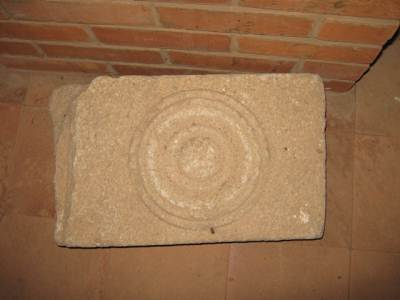 A carved tile used to fix on to walls