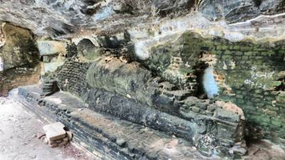 Reclined Buddha statue. Treasure hunters have destroyed it