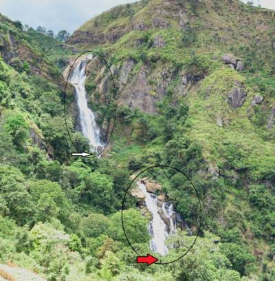First view of Kurundu Oya fall. Upper circle shows the upper part and lower circle shows the lower part. Note upper part also consists of two parts. White arrow shows the base of upper part we reached. Base of the lower cascade can't be seen here. Red arrow shows where we reached