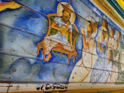 Ceiling of upper floor is decorated with beautiful paintings. Paintings of the outer wall say the story of golden Buddha statue and this temple.