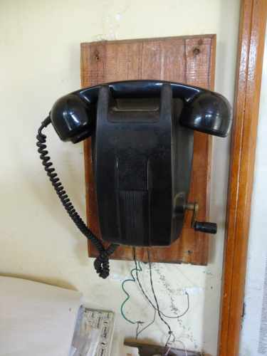 Very old phone with a handle at the bottom