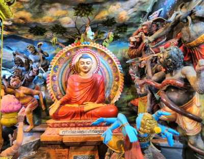 "Beautifully painted statues inside the image house. This indicates ""Mara Parajaya"" මාර පරාජය."