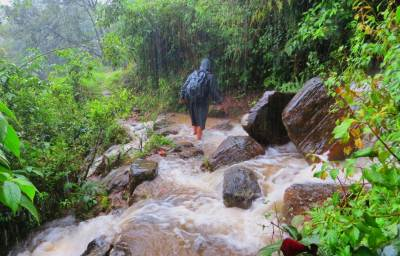 Heavy rain brought water streams over the foot pathway.