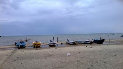 The boats waiting in the backdrop of a gloomy sky
