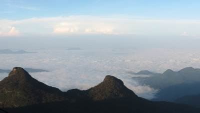 """Bana Samonala"" (බෑණ සමොනල) / false peak.  It is called false peak due to similarity to Adam's peak. Height is 2010m. It has two peaks."
