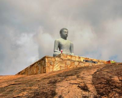 Newly built Buddha statue on the rock.