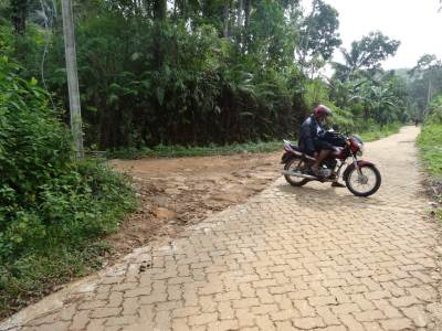 The turning to the left at Gamwasama. See those cement bricks-paved road, this turn is just at the beginning of that path