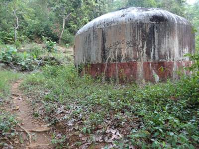 Get to this water tank and go passing it along the path
