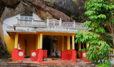 "The cave temple. This is around 450feet long cave and it has two compartments. One is an image house and other one is for ""Dewalaya"" දේවාලය."