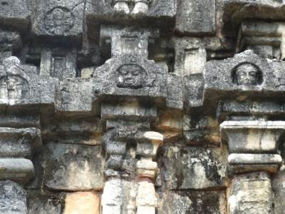 Faces of King Ravana in the middle and Lord Buddha on the right