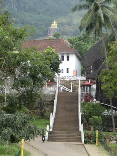 The entrance and the giant Golden Buddha in the far away similar to Dambulla