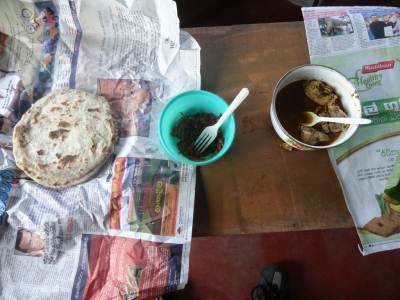 Breakfast of Roti, Lunu Miris and Chicken curry