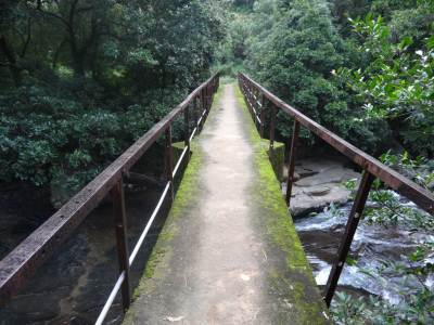 Bridge with rickety railings, note the absence of pipes along them. People have cut them off to use for antennas