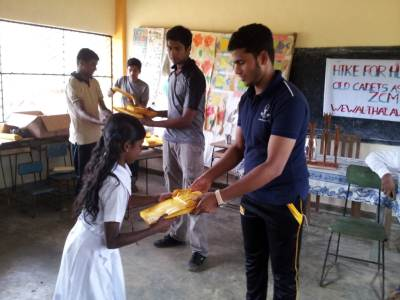 Donating gift packs to students.