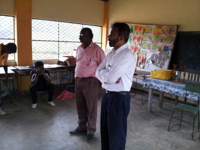 Lt. Ziyard is talking to parents and teachers on importance of Educating the children. College principal Mr. Mahendran stands next to him