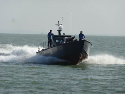 Another Navy craft returning to the jetty, they moved dangerously close to us