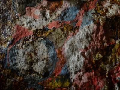 Faded paintings revealing colorful plaster underneath