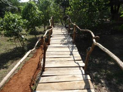 A makeshift wooden bridge is the path to the Chalet