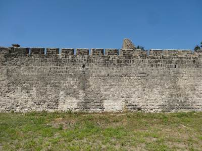 The front wall of the fort with gaps for the riflemen