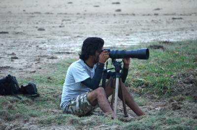 Aravinda is busy with his camera