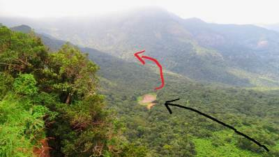 Summary of the route. Black arrow shows our approach to Ekanayaka Mama's house. Red arrow shows the direction towards two waterfalls. Picture was taken from Mini World's End-Pitawala Pathana. You can't see waterfalls from here
