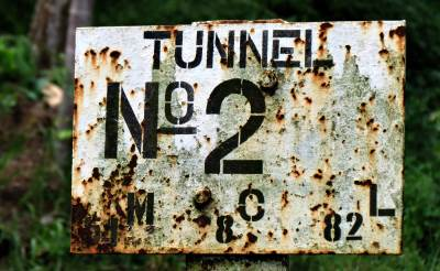 a board with tunnel number
