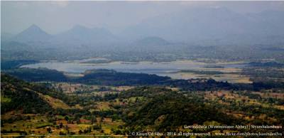 Muthukandiya reservoir zoomed. Maragala kanda is seen faintly in the backdrop
