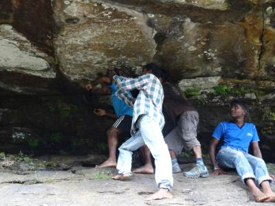 Kalu Malli and the team taking pics of the rock formation