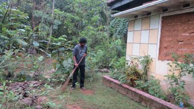 Ashan is cleaning the garden