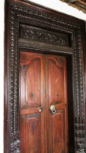 "Thick wooden door frame at ""Awasa Geya"" (ආවාස ගෙය)"