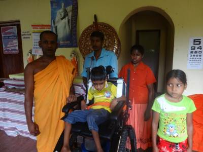The family with Medhananda Thero.