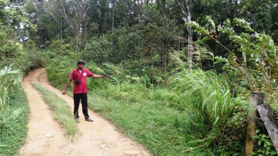 Ashan shows the foot path to Natural pool