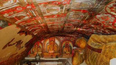 Paintings of Kandyan era and four Buddha statues within image house
