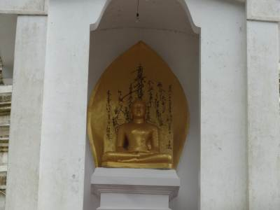Golden Buddha Statue placed in front of the Pagoda there