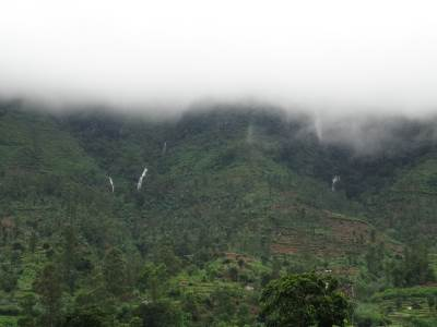 Mountain of Waterfalls - Hollangala. The No. 2 Falls is visible just underneath the misty layer to the right
