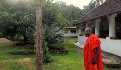 the chief monk showing us around