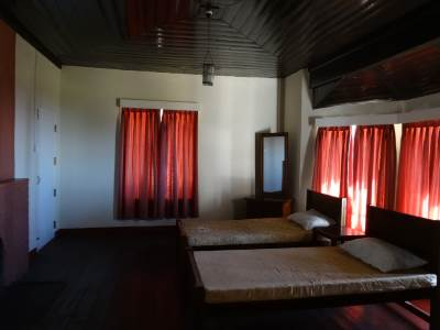 One of the bedrooms, note the wooden ceiling