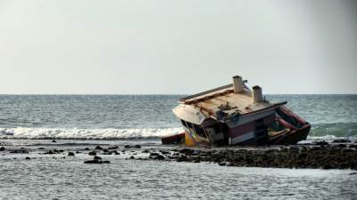 fishing boat which crashed on to the coral reef