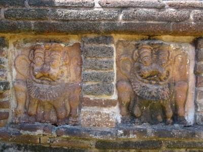Lion faced tablets etched into the wall